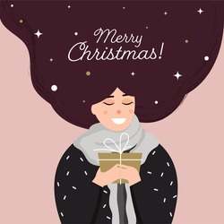 Cheerful Woman Holding A Gift Box With Long Wavy Hair On Pastel Pink Background For Merry Christmas Celebration.