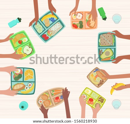 Children hands holding lunch boxes on table with healthy lunches food nutrition in school concept with lunchboxes