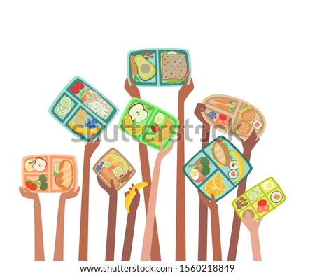 Children hands holding up lunch boxes with healthy lunches food nutrition in school concept with lunchboxes