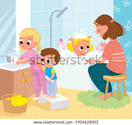 Children in bathroom doing everyday hygiene activities for kids,little boy cleaning the teeth, little girl washing hands with soap. Mother bathing baby. Mum washing baby. Photo stock ©