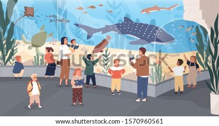 Children in oceanarium flat vector illustration. Parents and kids looking at ocean fishes cartoon characters. Aquarium, marine flora and fauna, underwater fish and sea animals variety.