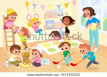 Children, kids play together having fun, fooling around in fine good mood, on playroom, playground. Preschool kids have fun. Children's activity in the kinder garden, primary school.