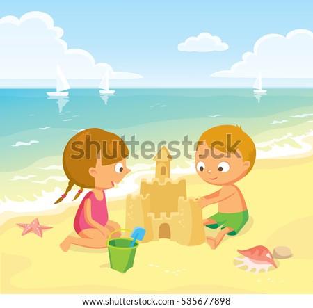 children making sand castle at