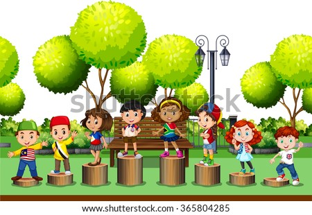 children standing on log in the