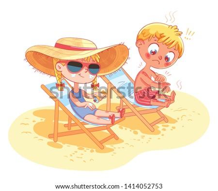 children sunbathe on the beach