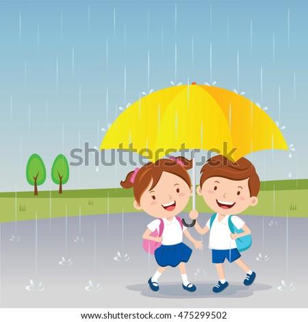 Children under the umbrella. Rainy day.