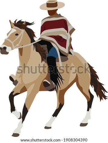 Chilean Huaso Country Man Wearing Traditional Manta Poncho and Chupalla Hat Riding Tan Horse Foto stock ©