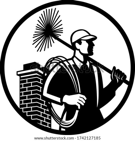 chimney sweep holding sweeper