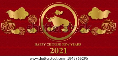 Chinese New Year 2021 year buffalo, golden buffalo characters, flowers and Asian elements in the background.