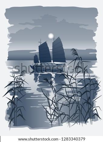 chinese sailboat junk on sunset