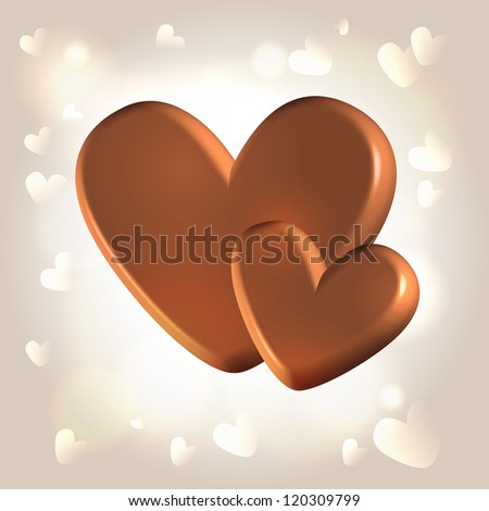 Chocolate couple of hearts for Valentine's day over glistening warm background