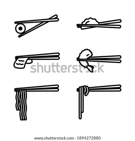 Chopsticks with food icon set. Wooden Chopsticks with Sushi, Ramen, Noodle, Shrimp Tempura, Sliced Beef, Dumpling isolated on white background. Stock photo ©