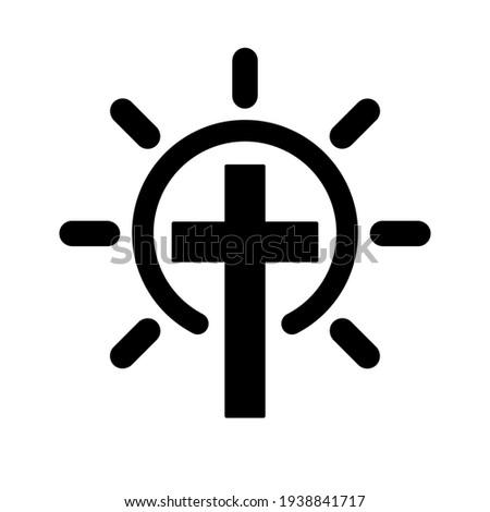 christian cross with sun rays