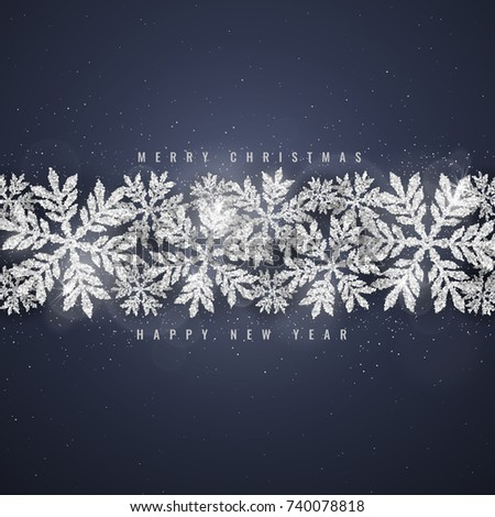 Stock Photo Christmas and new year dark blue background with silver glittering snowflakes on dark background. Merry Christmas greeting card.