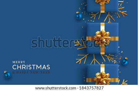 Christmas background. Realistic design with 3d Xmas decoration objects, gift box, bauble ball, gold metal shiny snowflake. glitter confetti. Flatlay top view composition. Greeting card, banner, poster