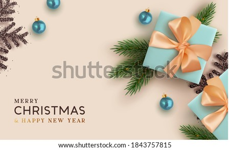 Christmas background. Realistic design with 3d Xmas decoration objects, gift box, fir branches, bauble balls, black shiny snowflake. Flatlay top view composition. Greeting card, banner, poster.