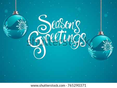Christmas balls and Seasons Greetings text for Christmas theme and background