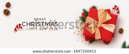 Christmas banner. Background Xmas design of realistic red gift box, 3d render pine branch and cone, sweet biscuit cane, gold confetti. Horizontal christmas poster, greeting card, headers for website
