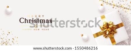 Christmas banner. Background Xmas design of sparkling lights garland, realistic gifts box, white balls and glitter gold confetti. Horizontal christmas poster, greeting cards, headers website