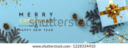 Stock Photo Christmas banner. Background Xmas design of sparkling lights garland, with realistic gifts box, black snowflake and glitter gold confetti. Horizontal christmas poster, greeting cards, headers, website