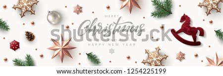 Christmas banner, timeline cover or header with Festive Elements - Rose Gold Stars, Glitter Snowflakes, Red wooden Rocking Horse and Pine Branches. Flat lay, top view.