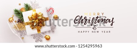 Christmas banner. Xmas bauble with gifts box and snowflake glitter, glasses champagne. Horizontal festive posters, greeting card, header, website. Objects viewed from above. Flat lay, Top view