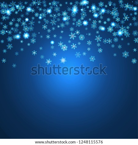 Christmas blizzard. Snowfall made from flat snowflakes with a random opacity effect on a dark blue background. For greeting cards for Christmas and New Year.