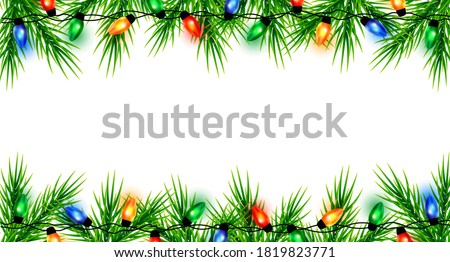 Christmas border with fir branches. Colorful Christmas frame with light bulb. Christmas lights decorative garland