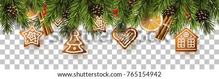 Christmas border with fir branches, traditional decorations and gingerbreads