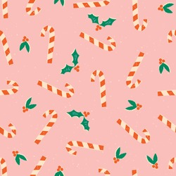 Christmas candy cane with mistletoe seamless pattern on pink background. Traditional Christmas food for celebration of New Year.