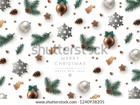 Christmas Decorative Background made of Pine Branches, Ornaments, Snowflakes, Cookies and Fir-cones. Flat lay, top view.