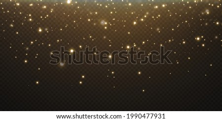 Christmas festive background of light confetti and small shining gold lights, on a transparent black background. Glittering gold texture. Christmas effect for luxury greeting rich card.