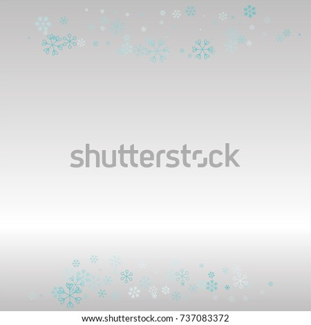 Christmas frame or border with random scatter falling blue snowflakes on a silvery background. #737083372