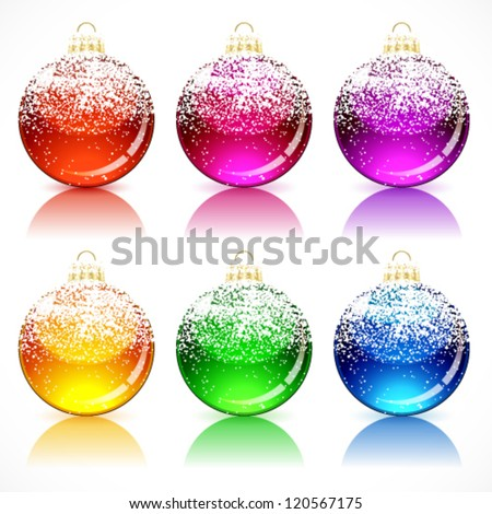 Christmas glass balls with a golden cap and loop, powdered snow.