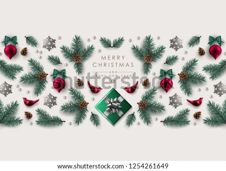 Christmas Greeting Card with Horizontal Decorative Border made of realistic pine branches, glass birds and Christmas ornaments, gift box and glitter snowflakes.  #1254261649