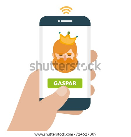 Christmas is here. Send your letter to The three wise men of orient from your cell phone. Hand holding smartphone. Caspar written in spanish