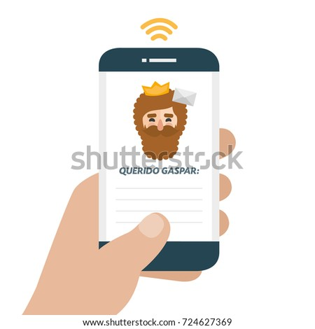 Christmas is here. Send your letter to The three wise men of orient from your cell phone. Hand holding smartphone. Dear Caspar written in spanish
