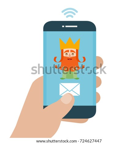 Christmas is here. Send your letter to The three wise men of orient from your cell phone. Hand holding smartphone. Caspar