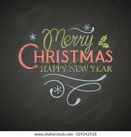 Christmas lettering with decorative elements on black board