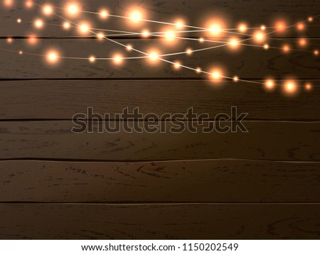 Christmas lights on dark wooden background. Glow garland. Vector glow xmas light bulbs on wires. Christmas banner with place for your design.