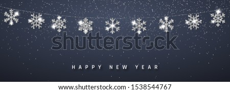 Christmas or New Year silver snowflake decoration garland on dark background. Hanging glitter snowflake. Vector illustration.