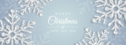 Christmas poster with shiny silver snowflakes on a white background. Vector illustration