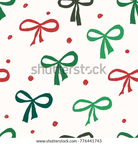 Christmas seamless repeat pattern with green and red bows and dots on white background. Holiday gift wrap, greeting card, wallpaper design.