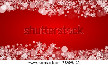 Christmas snowflakes on red background. Santa Claus colors. Horizontal Christmas snowflakes frame for holiday banners, cards, sales, special offers. Falling snow with bokeh for party celebration #752598130