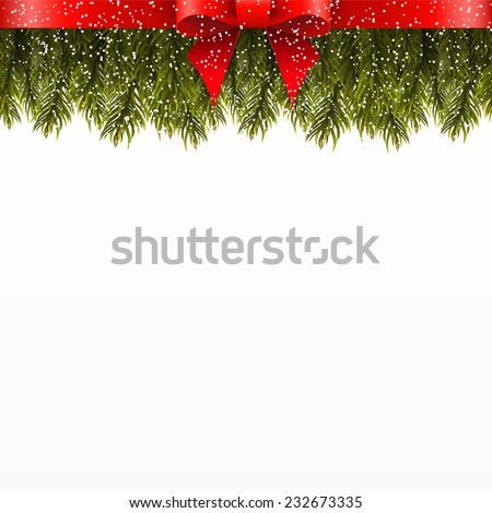 Christmas tree branch decorated with red bow