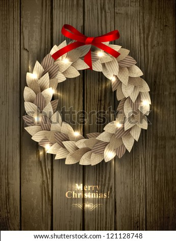 Christmas wreath made of paper leaves in eco country style decorated with red bow and sparkles