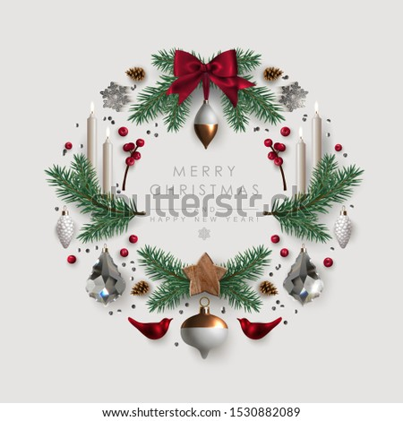 Christmas wreath made of pine branches, glass baubles and burning candles