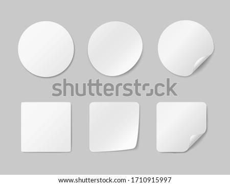Circle adhesive symbols. White tags, paper round stickers with peeling corner, isolated rounded plastic mockup signs, vector illustration