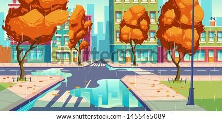 city crossroad in autumn rain