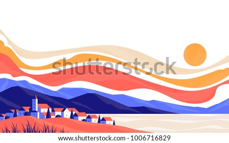 City landscape of cute small buildings on background of rocky mountains at sunrise